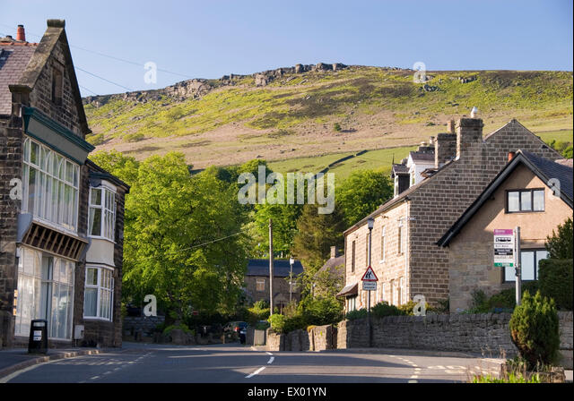 BAMFORD, Derbyshire, UK - June 04: Cottages in Bamford village nestled beneath Stanage Edge, Peak District on 04 - Stock Image