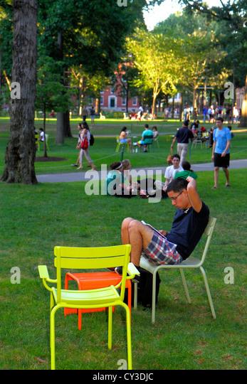 Boston Massachusetts Cambridge Harvard University campus Harvard Yard student chairs sitting - Stock Image