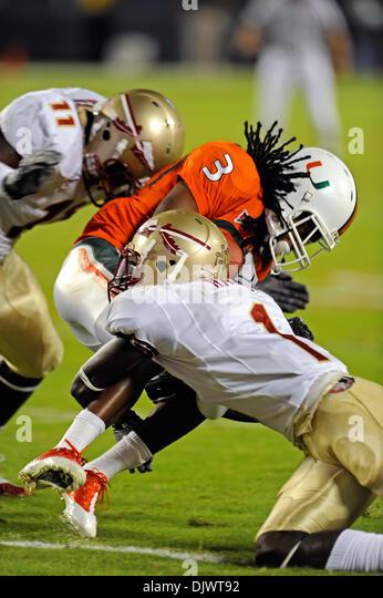 Oct. 10, 2010 - Miami, Florida, United States of America - October 9, 2010: Miami WR Travis Benjamin (3) is punished - Stock Image