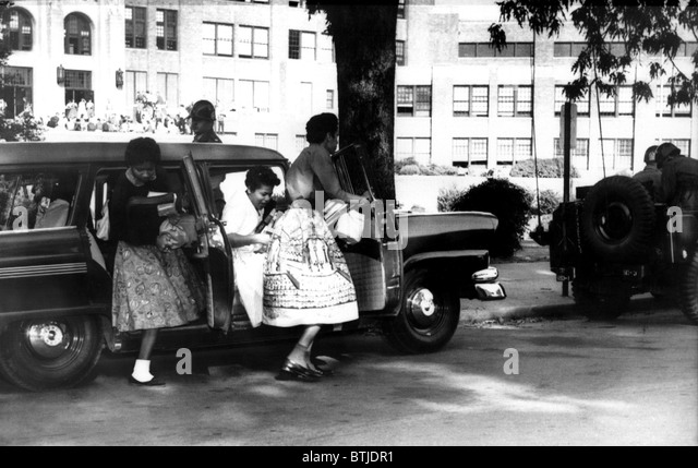 Little Rock, Arkansas: Black students of Central High arrive at school escorted by Federalized National guardsmen, - Stock Image