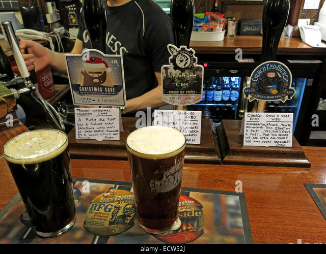 Three Xmas British Ales on a bar, craven Arms, Birmingham, England, UK - Stock Image