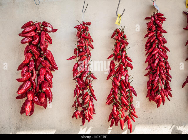 Chillies in spice market, Tropea, region Calabria, Italy - Stock Image