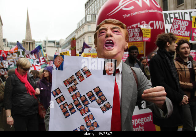 London, UK. March 18, 2017: A protestor with a Trump mask seen during the Stand Up To Racism demonstration on UN - Stock Image