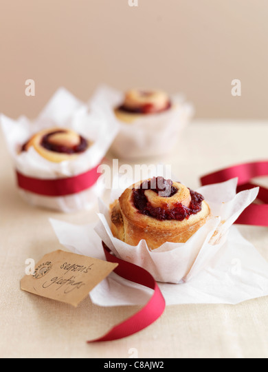 Redcurrant jelly pastry rolls - Stock Image