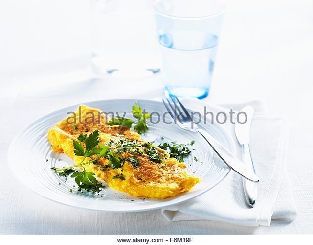 Omelette with fresh parsley - Stock Image
