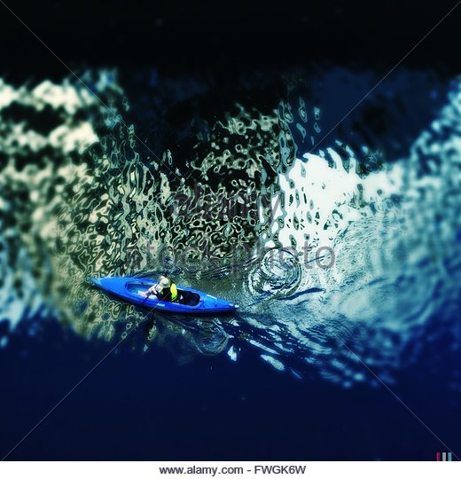 Elevated View Of Person In Canoe - Stock Image