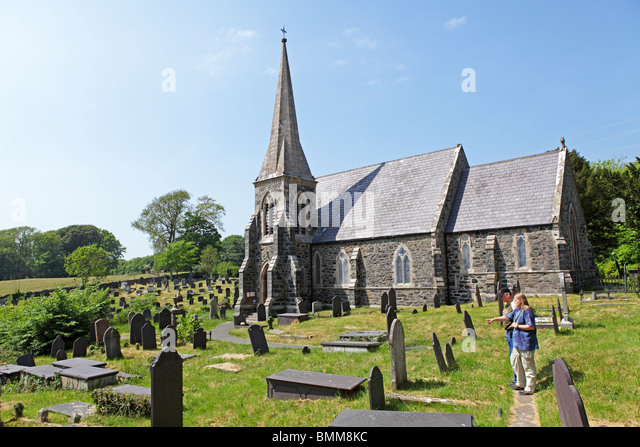 church and graveyard near Llanfairpwllgwyngyll... near Bangor, Anglesey Island, Wales, United Kingdom - Stock Image