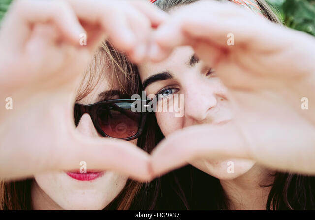 Best friends make a heart with their hands - Stock Image