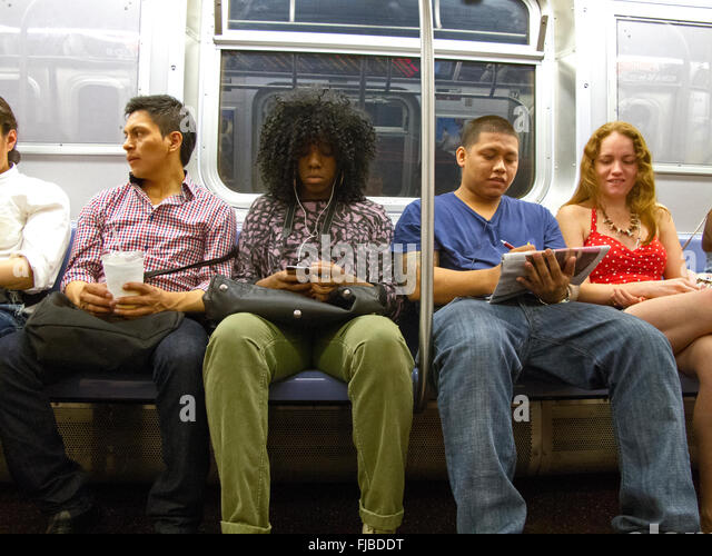 subway riders on train NYC - Stock Image