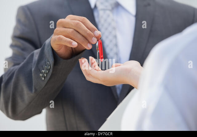 Estate agent giving the key to buyer - Stock Image