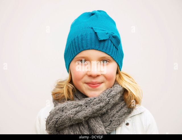Portrait of Young Girl Wearing Wool Hat and Scarf - Stock Image