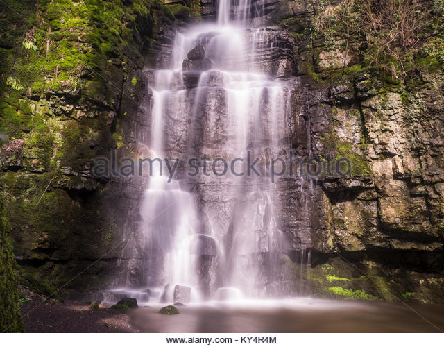 Swallet Waterfall In Peak District in Sunlight with Contrasting Rocks - Stock Image