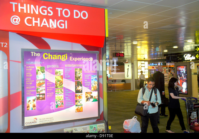 Singapore Changi International Airport SIN terminal concourse inside interior things to do information sign Asian - Stock Image