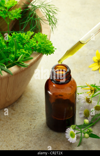 Herbal medicine with dropper bottle and wild flowers - Stock Image