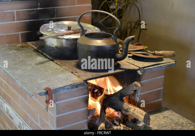 Jerk chicken cooked in wood-burning stove - Stock Image