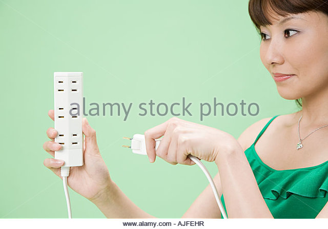 Woman with extension cord - Stock Image