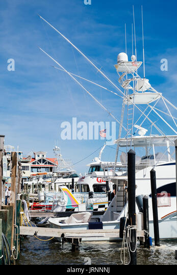 The Destin sport and commercial fishing boats moored at the Harborwalk Marina in Destin, Florida USA. - Stock Image