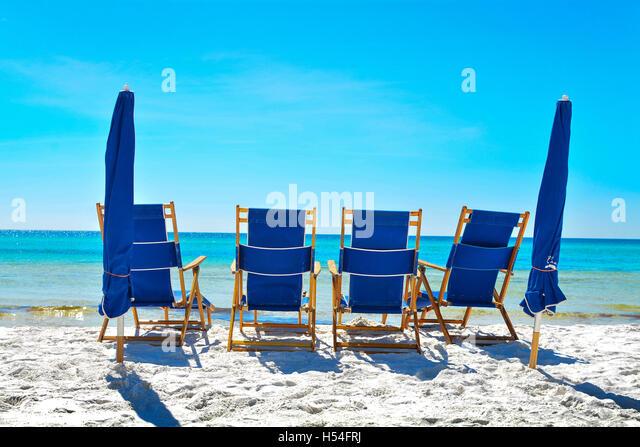 Beach umbrellas lounge chairs on stock photos beach for Beach chaise longue