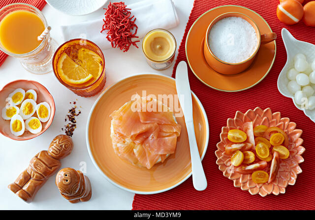 Table with fresh salmon, boiled eggs and tomatoes - Stock Image