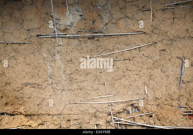 Background of brown adobe mud and straw. - Stock Image