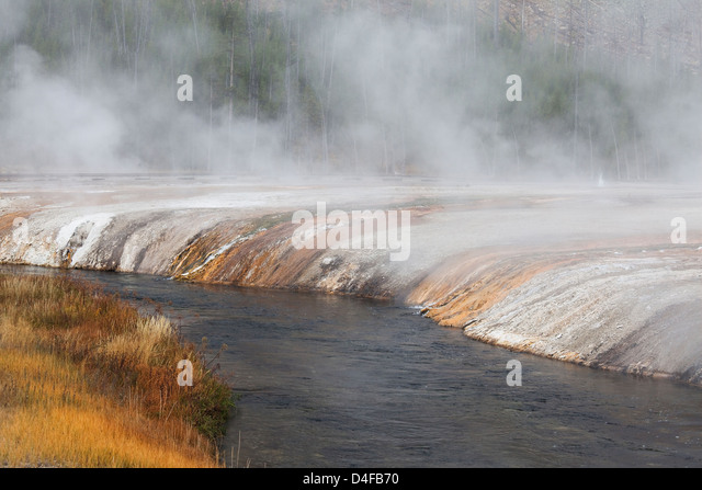 Mist over sand basin and river - Stock Image