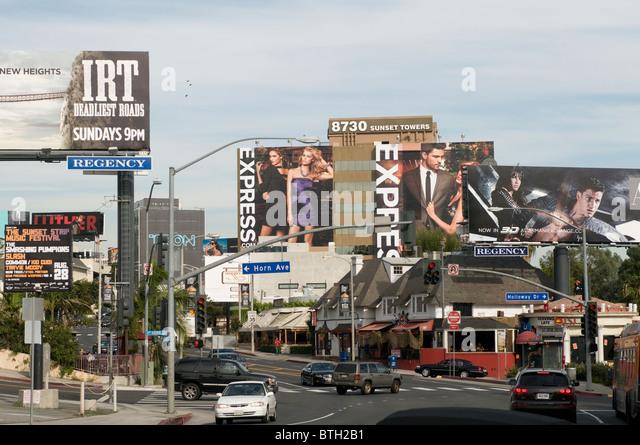 Giant billboards on Sunset Boulevard Hollywood Los Angeles California USA - Stock Image