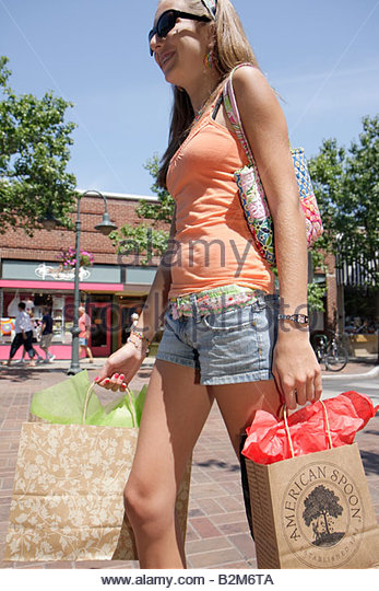 Michigan Traverse City Front Street shopping girl teen young adult bags fashion sunglasses - Stock Image