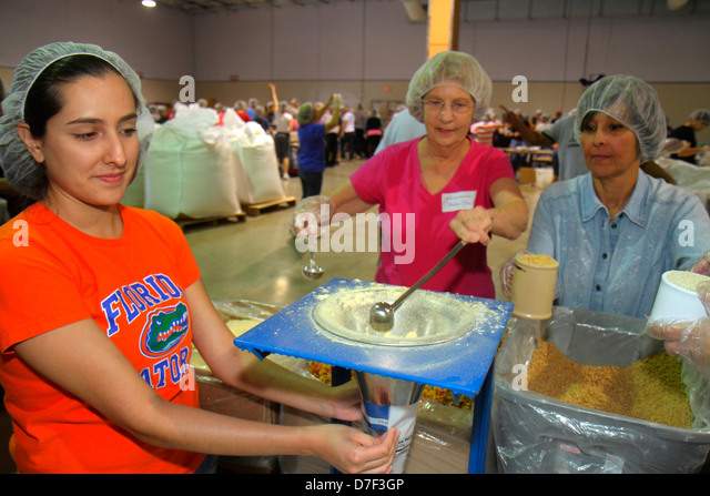 Miami Florida Miami-Dade County Fair And Expo Feed My Starving Children volunteer community service packing meals - Stock Image