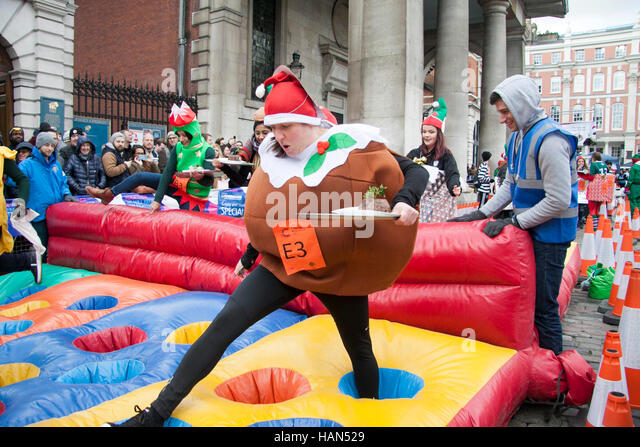 London, UK. 3rd Dec, 2016. Participants in the Great Pudding Race compete to raise money for Cancer Research UK - Stock Image