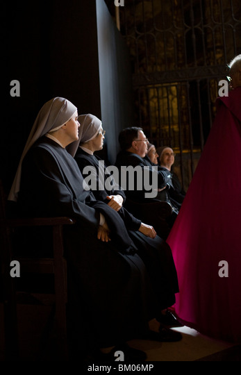 Clergy people inside Seville's cathedral, Spain - Stock Image
