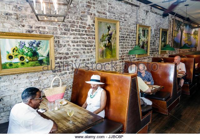 South Carolina Charleston SC Historic Downtown Virginia's On King restaurant southern cuisine dining Black man - Stock Image