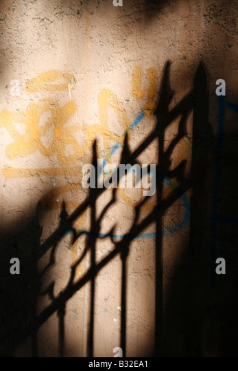 abstract gate fence shadow graffiti wall outdoors - Stock-Bilder