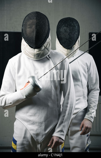 Portrait of two fencers holding fencing foils - Stock Image