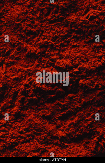 Red powder, extreme close-up, full frame - Stock Image