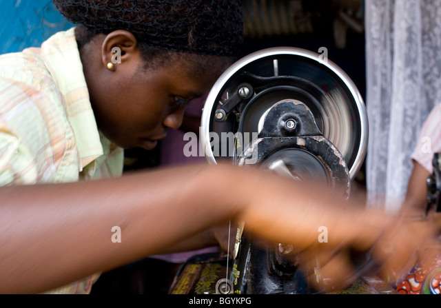 Young seamstress in Ghana, Africa - Stock Image