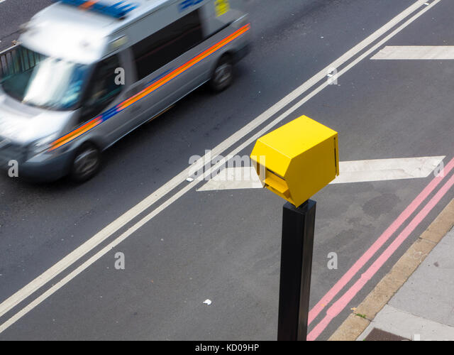 A police van speeding through a speed trap in London - Stock Image