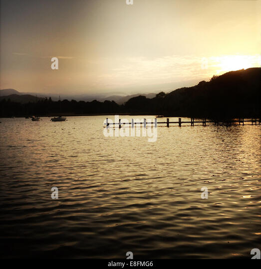 United Kingdom, English Lake District, Sunset over Lake Windermere - Stock Image