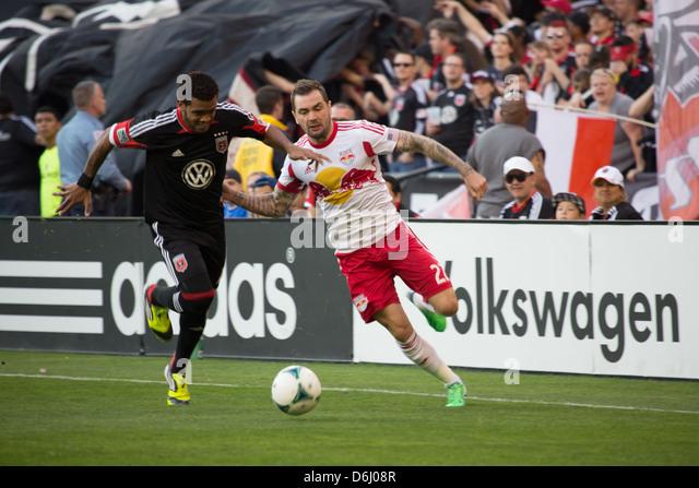 April 13th 2013 D.C. United midfielder Raphael Augusto (12) fights for the ball with NY RedBulls (27) Kosuke Kimura. - Stock Image
