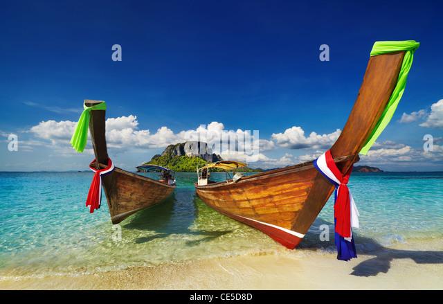 Longtail boats, Tropical beach, Andaman Sea, Thailand - Stock Image