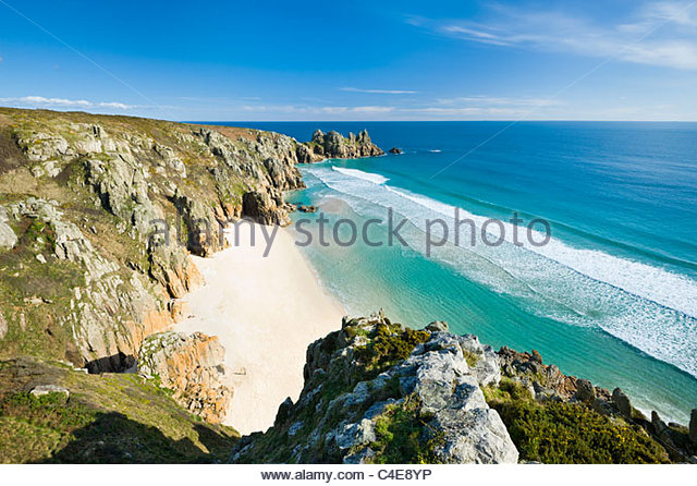 Logan Rock and Pednvounder beach, at Porthcurno, Cornwall. - Stock Image
