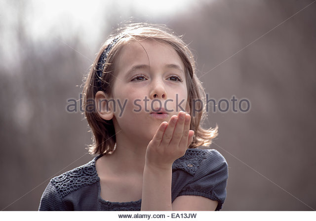 Portrait of pretty girl blowing a kiss - Stock Image