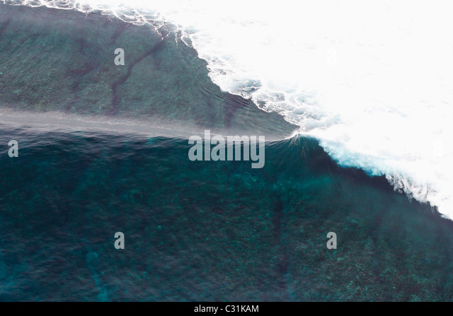 Aerial view of an empty wave breaking at Tavarua, Fiji - Stock Image