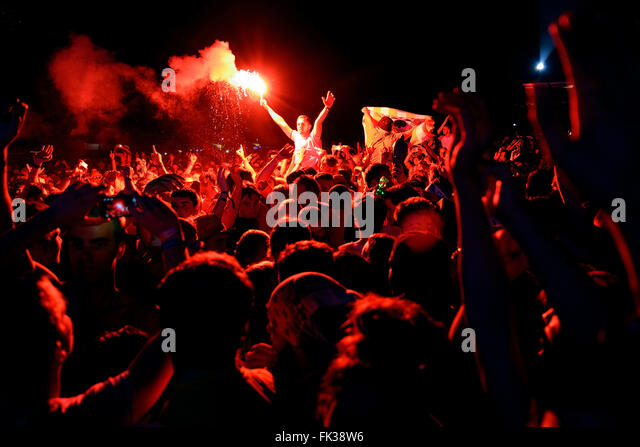 BENICASSIM, SPAIN - JULY 18: Man from the crowd with a burning flare at FIB Festival on July 18, 2014 in Benicassim, - Stock Image
