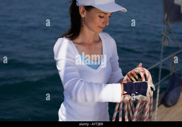 Woman handling a rope - Stock Image