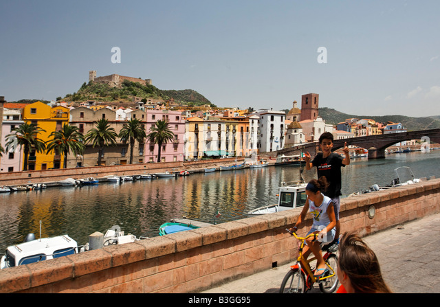 Italy Sardinia Bosa west coast canal children on bicycle - Stock Image