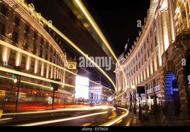 Driving Car At Night Passing Under Street Light