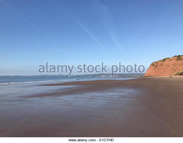 Low tide on the Jurassic Coast at Sandy Bay, Exmouth, Devon - Stock Image