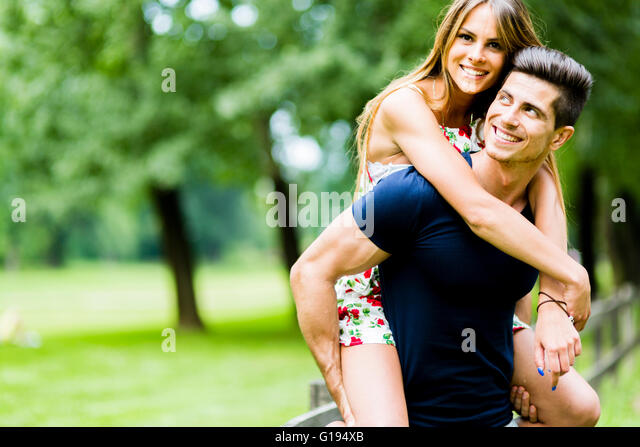 Happy couple in love having fun outdoors and smiling - Stock Image