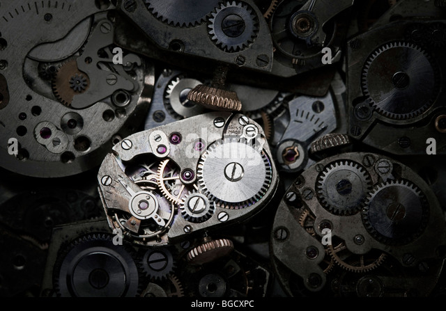 Close-up of antique clockwork. This is an extreme close-up of old clockwork so there is some dust visible. - Stock Image