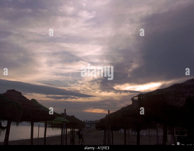Parasols at Dusk, La Cala beach,  La Cala, de Mijas , Spain, Costa del Sol, Andalucia, Andalusia Spain Spanish  - Stock Image
